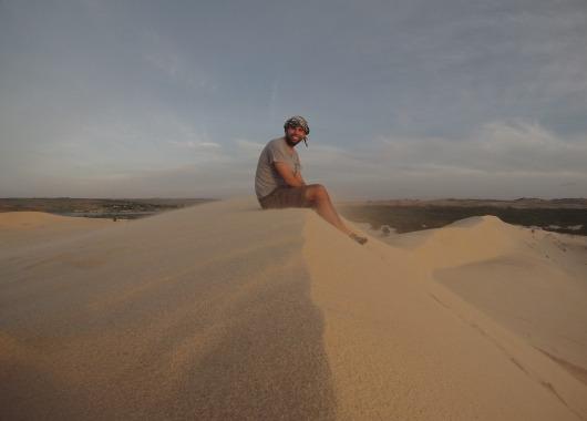 Sitting on a sand dune in Mui Ne, Vietnam.