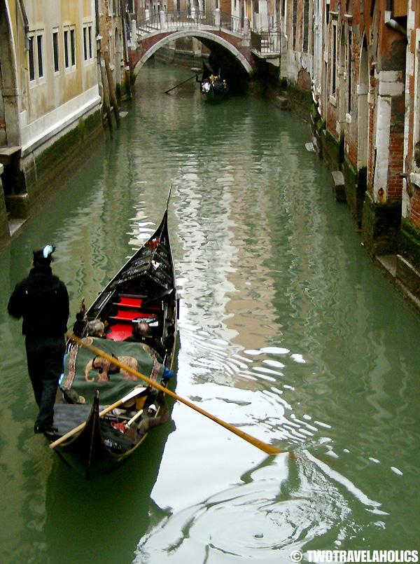 Gondola cruising down a Venice canal