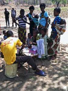 Health Worker Administering Malaria Tests in Zambia